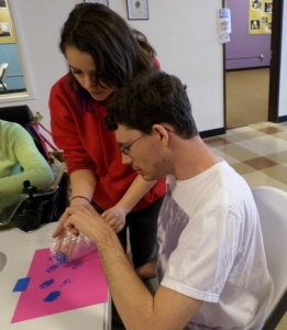 Hannah assists Matt with his bubble wrap painting.