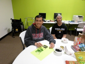 Jose and Chris cut up vegetables for their bean dip.